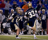 Sean Rogers (18) of Notre Dame celebrates the game-winning overtime goal by teammate David Earl (33) during the Face-Off Classic in at M&T Stadium in Baltimore, MD