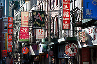 Asian storefront signs at Doyers Street in Chinatown, New York City