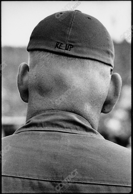 US Army Sergeant with RE UP stitched into his hat. RE UP is short for Re-Enlisting in the Army. South Vietnam, November 1970.