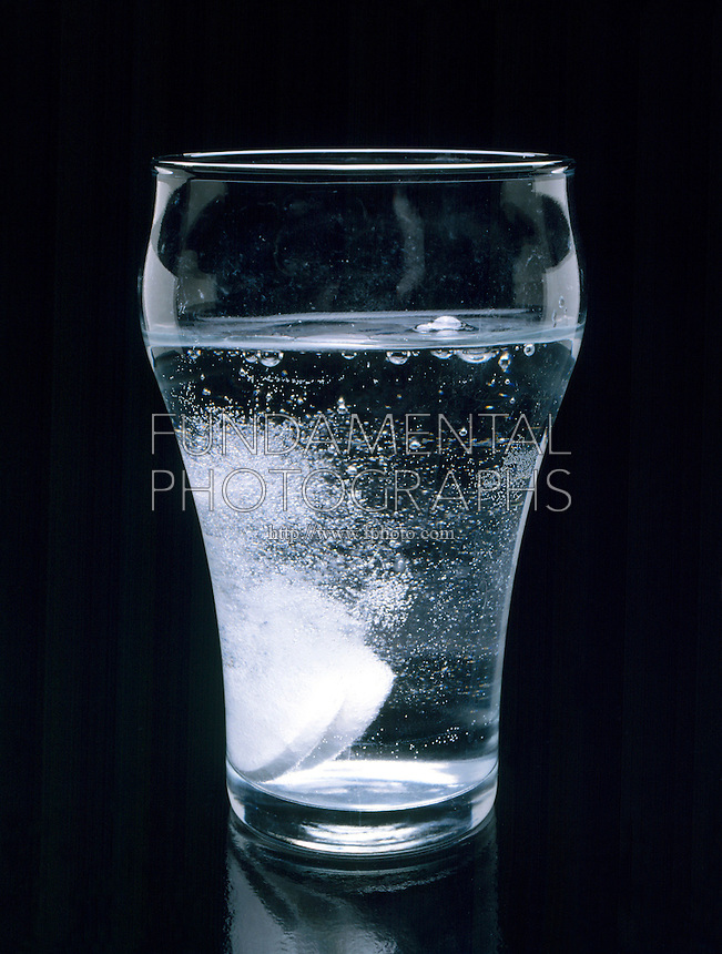 CARBONATION OF ALKA SELTZER IN GLASS<br /> Alka Seltzer Effervesces In Water<br /> Alka Seltzer is a combination of sodium bicarbonate (NaHCO3) and citric acid. When it is dropped into water, carbon dioxide is released and bubbles up to the surface.