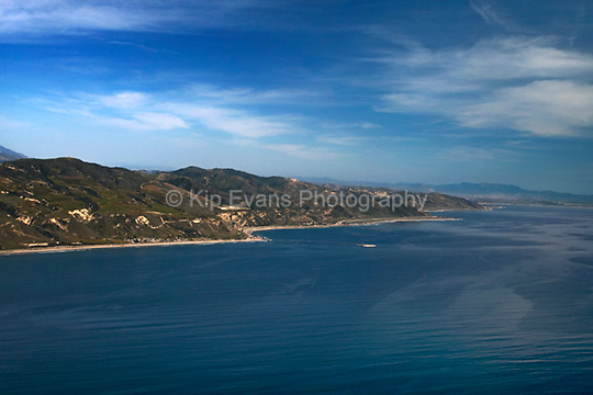 View of Rincon Island and the Santa Barbara coast from the air looking east. Rincon Island is an artificial island located off Rincon Beach in Ventura County, California. The island is situated approximately 3,000 feet (910 m) offshore in 55 feet (17 m) of water. The island was constructed in between 1957 and 1958 for the specific purpose of well drilling and oil and gas production (wiki 2009).