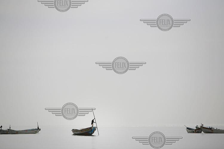 A fisherman works near the village of Gunjur.