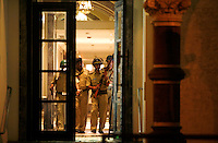 A police team inside the Taj Mahal Palace Hotel, after multiple terrorist attacks were launched in Mumbai on 26/11/2008..