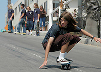 A group of teenagers slalom down Bicknell Hill on their Zephyr's on Friday, Aug 3, 2007 in Santa Monica.