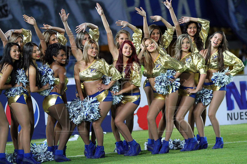 BOGOTA -COLOMBIA. 09-02-2014. Porristas  de Millonarios alientan su equipo  contra Nacional   partido por la cuarta fecha de La liga Postobon 1 disputado en el estadio El Campin. /  Cheerleaders of Millonarios encourage his team against the Atletico Nacional National Party's fourth date Postobon one league match at El Campin Stadium. Photo: VizzorImage/ Felipe Caicedo / Staff