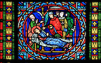 The death of Saint Louis in Tunis during the 8th Crusade, surrounded by Guillaume de Chartres, his chaplain, giving the eucharist, Geoffroy de Beaulieu, his brother the future Philippe III, and his son-in-law Thibaut de Champagne, by master glazier Laurent Gaspar Gsell after drawings by Louis Steinheil, stained glass window, 1871, in the apse of the Collegiale Notre-Dame de Poissy, a catholic parish church founded c. 1016 by Robert the Pious and rebuilt 1130-60 in late Romanesque and early Gothic styles, in Poissy, Yvelines, France. The windows of the apse tell the story of Saint Louis or King Louis IX of France, born in Poissy in 1214. The Collegiate Church of Our Lady of Poissy was listed as a Historic Monument in 1840. Picture by Manuel Cohen
