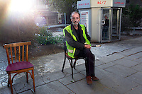 A man sits out on the street in Tbilisi.