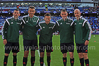 Cardiff City Stadium, Cardiff, South Wales - Tuesday 12th Aug 2014 - UEFA Super Cup Final - Real Madrid v Sevilla - <br /> <br /> The match officials with the Referee Mark Clattenburg in the centre<br /> <br /> <br /> <br /> <br /> Photo by Jeff Thomas/Jeff Thomas Photography