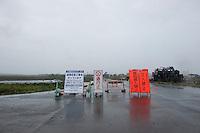 Landscape view of warning signs on a road following the 311 Tohoku Tsunami in Ishinomaki, Japan  © LAN