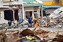 April 2nd, 2011, Ofunato, Japan - An elderly man surveys damaged houses in Ofunato City, Iwate Prefecture, on April 2, 2011, three weeks after this northeastern Japanese fishing port nestled deep inside an inlet was destroyed by a magnitude 9.0 earthquake and ensuing tsunami. (Photo by Natsuki Sakai/AFLO) [3615] -mis-....