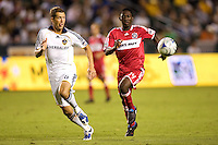 LA Galaxy defender Gregg Berhalter and Chicago Fire forward Patrick Nyarko move to the ball. The LA Galaxy defeated the Chicago Fire 1-0 at Home Depot Center stadium in Carson, California on Friday October 2, 2009...