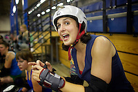 Shellby Shattered cheers on teammates during a roller derby practice in Wilmington, Massachusetts. Roller derby is an American contact sport, popular with young women, which combines both athleticism and a satirical punk third-wave feminism aesthetic.