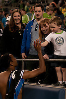 James Riley (l) high fives a young fan  in the Seattle Sounders 2-1 win against San Jose Earthquake on Saturday, June 13, 2009 at Quest Field in Seattle, WA.
