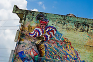 A colorful mural showing the Afro-Cuban religious motive (a drummer) painted on house in Santiago de Cuba, Cuba, August 1, 2009. The Palo religion (Las Reglas de Congo) belongs to the group of syncretic religions which developed in Cuba amongst the black slaves, originally brought from Congo during the colonial period. Palo, having its roots in spiritual concepts of the indigenous people in Africa, worships the spirits and natural powers but can often give them faces and names known from the Christian dogma. Although there have been strong religious restrictions during the decades of the Cuban Revolution, the majority of Cubans still consult their problems with practitioners of some Afro Cuban religion.