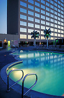 hotel swimming pool with lights on at dusk. Anaheim California USA.