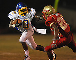 Oxford High's Glen Gordon (10) is run out of bounds by Lafayette High's Jeremiah Jones (26) at William L. Buford Stadium in Oxford, Miss. on Friday, September 2, 2011. Lafayette won 40-12