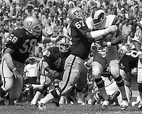 Oakland Raiders Greg Slough and Harold Rice stop Rams runner...(1971 photo/Ron Riesterer)
