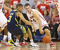 Ohio State Buckeyes guard Aaron Craft (4) steals the ball from Michigan Wolverines guard Trey Burke (3) in second half action at Value City Arena in Columbus, Ohio on January 13, 2013.  (Chris Russell/The Columbus Dispatch)