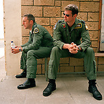 Two RAF pilots listen to flight-briefing by 'Red Arrows', Britain's Royal Air Force aerobatic team for whom they want to fly.