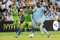 Fredy Montero (17) ) forward Seattle Sounders challenges  Birahim Diop (20) midfielder Sporting KC for the ball... Sporting Kansas City were defeated 1-2 by Seattle Sounders at LIVESTRONG Sporting Park, Kansas City, Kansas.