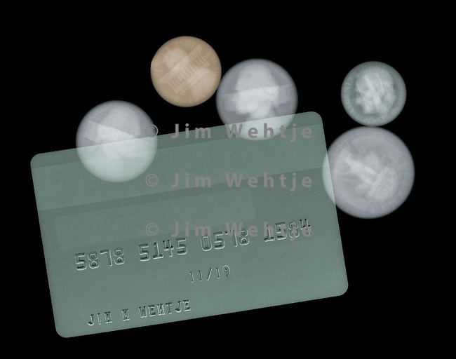 X-ray image of a credit card and coins (color on black) by Jim Wehtje, specialist in x-ray art and design images.