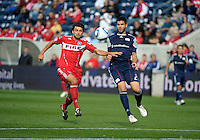 Chicago midfielder Baggio Husidic (9) battles for the ball with New England defender Franco Coria (2).  The Chicago Fire defeated the New England Revolution 3-2 at Toyota Park in Bridgeview, IL on Sept. 25, 2011.