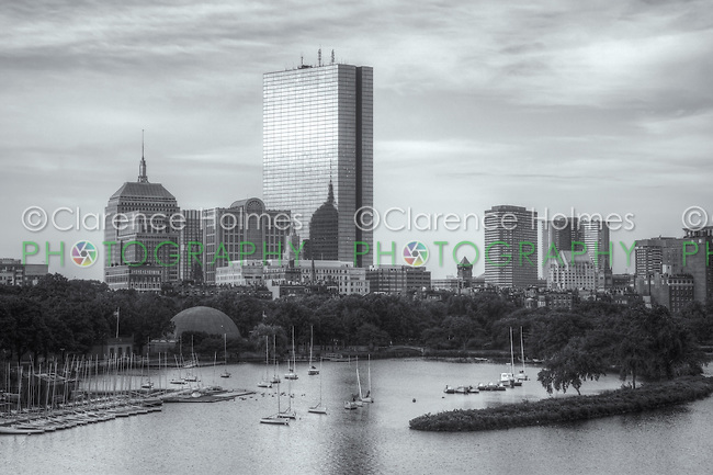 View of the Boston skyline including the John Hancock building, as seen over the Charles River from the Longfellow Bridge.  Also visible are the Hatch Memorial Shell and boat basin along the river.