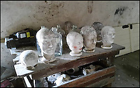 BNPS.co.uk (01202 558833)<br /> Pic: ThomsonRoddick/BNPS<br /> <br /> The death masks were found on a table at the top of a barn.<br /> <br /> These disturbing Victorian plaster cast heads of notorious criminals are a far cry from today's bland mugshots of lowlifes.<br /> <br /> Two of the heads have been identified as Benjamin Courvoisier, a serial killer in the mould of Jack the Ripper, and coachman Daniel Good who mutilated his pregnant mistress. <br /> <br /> In total, nine heads were discovered at an outbuilding at a rural home just outside Penrith, Cumbria, which have now fetched almost &pound;40,000 at auction. <br /> <br /> Experts predicted the collection of heads would sell for &pound;2,000  but Courvoisier's head alone went for &pound;20,000.<br /> <br /> Two of the heads were made by the famous British exponent of phrenology, James De Ville, who built a private museum of more than 5,000 specimens.