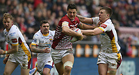 Wigan Warriors' Anthony Gelling is tackled by Huddersfield Giants' Alex Mellor <br /> <br /> Photographer Stephen White/CameraSport<br /> <br /> Betfred Super League Round 5 - Wigan Warriors v Huddersfield Giants - Sunday 19th March 2017 - DW Stadium - Wigan<br /> <br /> World Copyright &copy; 2017 CameraSport. All rights reserved. 43 Linden Ave. Countesthorpe. Leicester. England. LE8 5PG - Tel: +44 (0) 116 277 4147 - admin@camerasport.com - www.camerasport.com