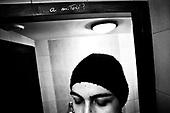Wroclaw 11.2009 Poland<br /> Transsexual Marina Till in the ladies toilet. Inscription on the niche &quot;what about love?&quot;<br /> Marina Till, a transsexual, has had numerous medical examinations and treatments, such as a very intense hormonal therapy, at times seriously weakening her organism. For a long time she has been dreaming  about a sex change surgery that she can not afford. She does not accept herself and her body. Frequent suicide attempts and alcohol abuse, are means of escape from the body she lives in. A body that does not belong to her.<br /> Photo: Adam Lach / Napo Images<br /> <br /> Transseksualista Marina Till w toalecie damskiej.<br /> Transseksualista Marina Till przeszla juz setki kuracji hormonalnych i badan psychoterapeutycznych, ktore w znaczny sposob wycienczyly jej organizm. Od wielu lat marzy o zmianie plci lecz najzwyczajniej nie stac ja na zbyt kosztowna operacje. Nie akceptuje siebie, nie akceptuje swojego ciala. Czeste proby samobojcze i znaczne ilosci alkoholu sa dla niej sposobem na ucieczke, przede wszystkim od swiadomosci ze cialo w ktorym zyje nie nalezy do niej.<br /> Fot: Adam Lach / Napo Images