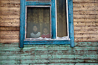 Pupils look out of their classroom window in the school building in Oymyakon. The village is known as the Northern Pole of Cold as it has recorded the lowest ever temperatures for an inhabited place on earth, the coldest being -67.7 degrees celcius.
