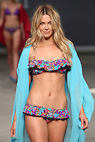 SYDNEY, AUSTRALIA - AUGUST 25:  Model Jennifer Hawkins practices the run through backstage ahead of the Myer show as part of Mercedes Benz Fashion Festival Sydney 2011 at Sydney Town Hall on August 25, 2011 in Sydney, Australia.  (Photo by Marianna Massey/WireImage)
