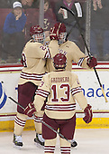Scott Savage (BC - 28), Kevin Hayes (BC - 12) and Johnny Gaudreau (BC - 13) celebrate Hayes' goal. - The Boston College Eagles defeated the visiting University of Notre Dame Fighting Irish 4-2 to tie their Hockey East quarterfinal matchup at one game each on Saturday, March 15, 2014, at Kelley Rink in Conte Forum in Chestnut Hill, Massachusetts.