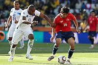 Wilson Palacios of Honduras (L) and Matias Fernandez of Chile (R)