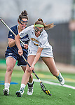 25 April 2015: University of Vermont Catamount Attacker Meredith Moore, a Sophomore from Baltimore, MD, gathers possession during game action against the University of New Hampshire Wildcats at Virtue Field in Burlington, Vermont. The Lady Catamounts defeated the Lady Wildcats 12-10 in the final game of the season, advancing to the America East playoffs. Mandatory Credit: Ed Wolfstein Photo *** RAW (NEF) Image File Available ***