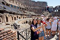 Roma 5 Agosto 2015<br /> Grande affluenza di visitatori italiani e stranieri al Colosseo,  sono circa  22000 le persone che ogni giorno dall'inizio della stagione turistica, hanno visitato l'antico anfiteatro e l'area archeologica centrale. Il monumento pi&ugrave; celebre della Capitale si conferma cos&igrave; tra i luoghi pi&ugrave; amati dai turisti italiani e stranieri. Il ministero dei Beni culturali a stanziato 18,5 milioni di euri per ricostruire  l&rsquo;arena del Colosseo come nell&rsquo;Ottocento. Turiste giapponesi si fanno un selfie, all'interno del Colosseo, usando un selfie stick allungabile.<br /> Rome August 5, 2015<br /> Large influx of Italian and foreign visitors to the Colosseum, are about 22000 people every day from the beginning of the tourist season, they visited the ancient amphitheater and the archaeological center. The most famous monument of the capital is confirmed as one of the most loved by Italian and foreign tourists. The Ministry of Culture it allocated 18.5 million  euros to rebuild the arena of the Coliseum as in the nineteenth century. Japanese tourists will make a selfie using an extendable stick selfie.