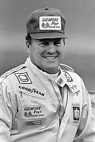 DAYTONA BEACH, FL - FEBRUARY 14: AJ Foyt pauses in the pit lane after qualifying his Oldsmobile for the Daytona 500 NASCAR Winston Cup race at the Daytona International Speedway in Daytona Beach, Florida, on February 14, 1982.