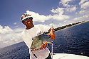 Fisherman with Blue-fin Trevally caught off Arno Atoll; Marshall Islands, Micronesia.