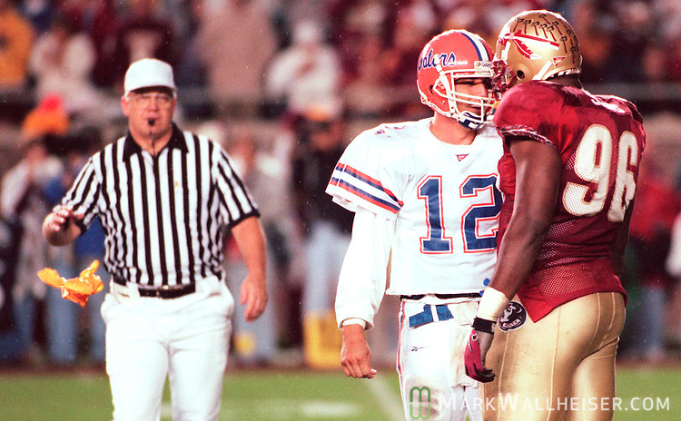 Florida State defensive tackle Larry Smith (96) gets .flagged for a personal foul after venturing into the backfield .after the play was over and trash talking with Gator quarterback .Doug Johnson in the third quarter in Tallahassee, Florida November 21, 1998...
