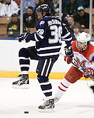 Phil DeSimone (UNH - 39), Andy Miele (Miami - 17) - The University of New Hampshire Wildcats defeated the Miami University RedHawks 3-1 (EN) in their NCAA Northeast Regional Semi-Final on Saturday, March 26, 2011, at Verizon Wireless Arena in Manchester, New Hampshire.