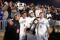 Wake Forest Demon Deacons forward Alimer Gonzalez (15), defender Julian Valentin (4), goalkeeper Brian Edwards (1), and defender Pat Phelan (5) pose with the trophy in front of fans after the game. The Wake Forest Demon Deacons defeated the Ohio State Buckeyes 2-1 in the finals of the NCAA College Cup at SAS Stadium in Cary, NC on December 16, 2007.