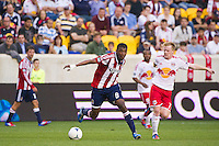 Oswaldo Minda (8) of CD Chivas USA and Dax McCarty (11) of the New York Red Bulls. The New York Red Bulls and CD Chivas USA played to a 1-1 tie during a Major League Soccer (MLS) match at Red Bull Arena in Harrison, NJ, on May 23, 2012.