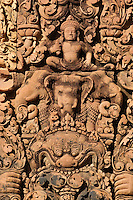 Banteay Srei with bas relief in red sandstone depicts Hindu mythology in fine detail, 10th century Khmer  architecture at Angkor Wat -  Siem Reap, Cambodia..