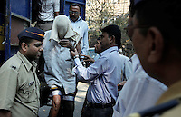 Somali pirates are led in to the Mumbai Army & Navy court after being captured by the Indian Navy. The pirates held 24 hostages from Thailand and Myanmar (Burma) for 10 months after their trawlers sailed into Somali waters.