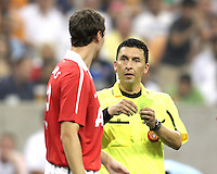 Jonny Evans #23 of Manchester United receives a yellow card from referee Jorge Gonzalez during the 2010 MLS All-Star match against the MLS All-Stars at Reliant Stadium, on July 28 2010, in Houston, Texas .MANU won 5-2.
