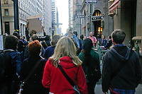 Protester march down Broadway towards Wall Street,  during the Occupy Wall Street Protest in New York City October 6, 2011.
