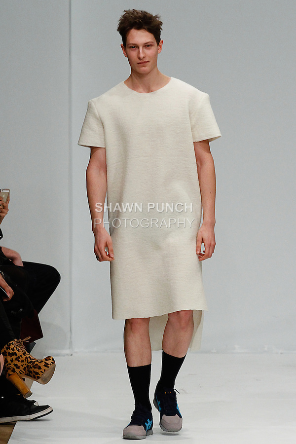Model walks runway in an outfit from the Apollonius Autumn Winter 2014 collection, by Emma Liljedahl, at the Designer's Premier Fall 2014 fashion show, during New York Fashion Week Fall 2014, February 9, 2014.