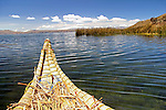 South America, Bolivia, Lake Titicaca. Reed boat of Uros floating reed islands of Lake Titicaca.