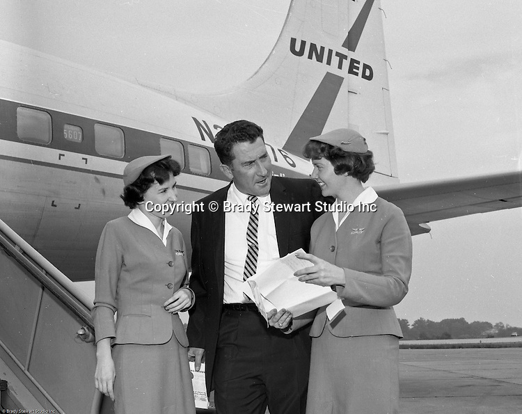 Greater Pittsburgh International Airport:  View of Fred Hutchinson, manager of the Cinicinnati Reds, arriving at the airport for a game with the Pittsburgh Pirates - 1960.  The on location photographic assignment was for United Airlines. The 1960 Cincinnati Reds finished in sixth place in the National League standings, 28 games behind the National League and World Series champion Pittsburgh Pirates!  The highlight for me in this set of images was of the one of Bob Purkey Sr.  I had the opportunity to know Bob Sr while playing high school baseball with his son, Bob Purkey Jr.  For many years, Bob Purkey Sr had a successful insurance business in Bethel Park Pa.