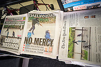 Headlines of New York newspapers on Thursday, January 8, 2014 report on the previous day's terrorist attack and murder in the Paris headquarters of Charlie Hebdo, a satirical magazine. Twelve people were murdered in the attack, the worst terror attack in Eurpope since the London bombing of 2005. (© Richard B. Levine)